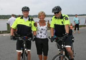 Officers Paul Somers and Chris Smith with Kim Carrigan from Fox 25 News